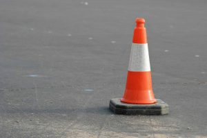 Red/Orange UK Road Traffic Cone on road